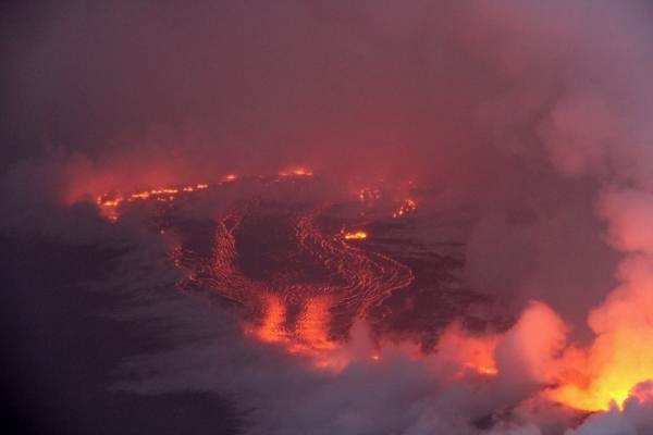 Lava meets the ocean in the morning mists.  U.S. Geological Survey