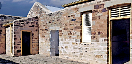 Old Police Stables and Lock-Up exemplifying a stone front over clay wattle and daub with an imported corrugated iron roof (tripadvisor.com.au)