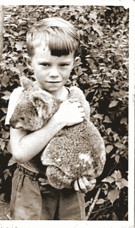 Seven-year-old Owen with baby Koala nestled in his arms (Courtesy of Owen Pointon)